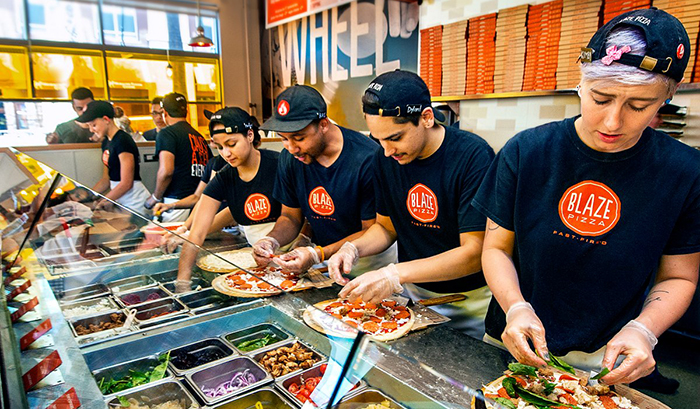 What a Blaze Pizza assembly line looks like.