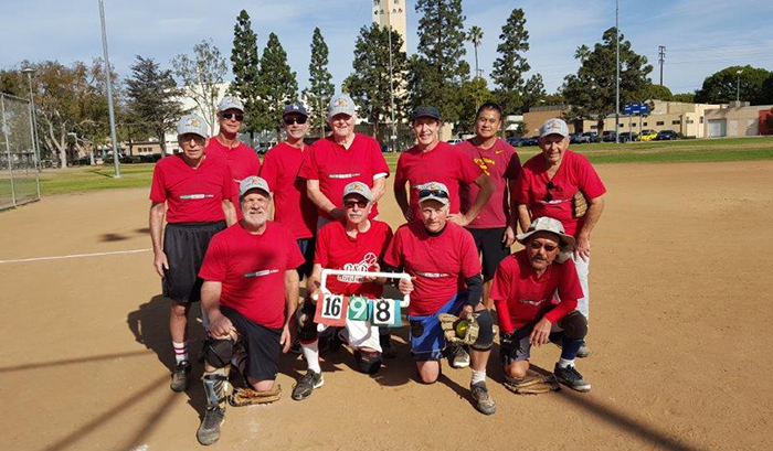 Red Team poses at Veterans Park after winning title. Top, from left: Cyril Barnet, Joe Tannerbauer, Tony Luca, Cliff Cullings, Ken Sackman, Steve Wong and Murray Krieger.  Kneeling: Jim Berger, league commissioner Richard Jebejian, team manager Bart Mills and Glenn Honda.