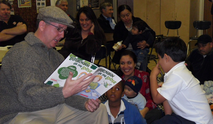 "Mayor O'Leary reads ""Leprechaun on the Loose"" to families at the Julian Dixon Library. Photo: Culver City Times"