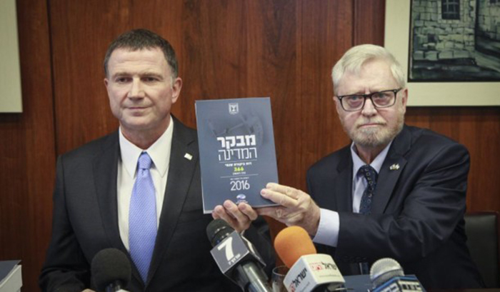 State Comptroller Yosef Shapira, right, hands State Comptroller's report to Knesset Speaker Yuli Edelstein this morning. Photo: Issac Harari/Flash90