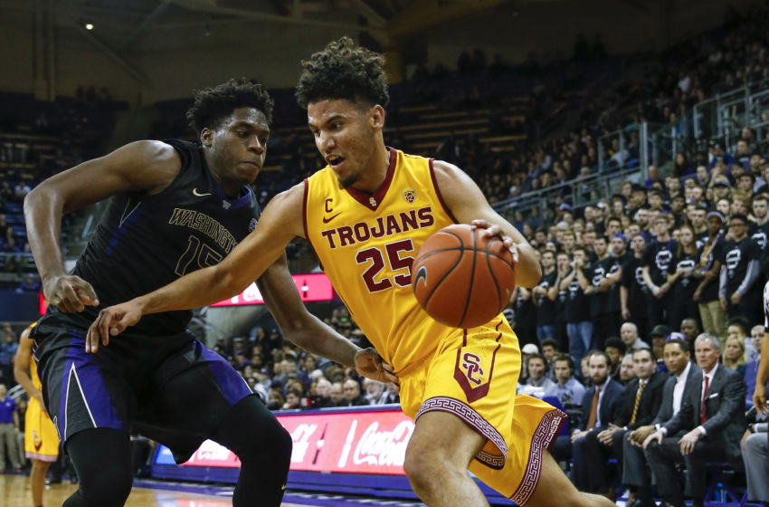 Trojans' Bennie Boatwright drives in last night's tournament win