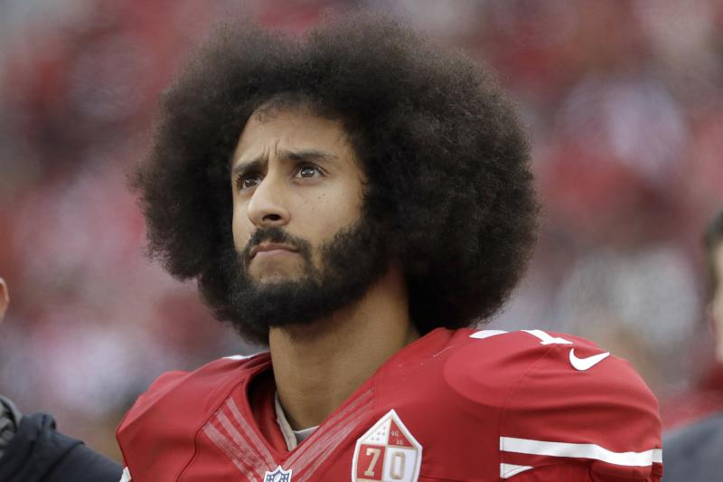 Colin Kaepernick, left, and his hair, right. Photo, Marcio Jose Sanchez/Associated Press